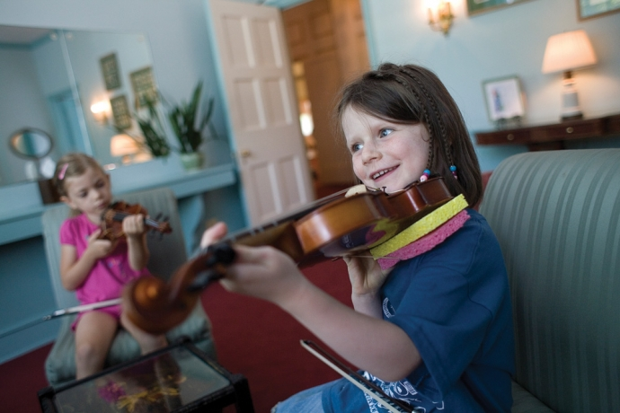 Sadie Collins takes a fiddle class during OPFC 2012. Photo by David Pierini, used with permission from The Wednesday Journal.